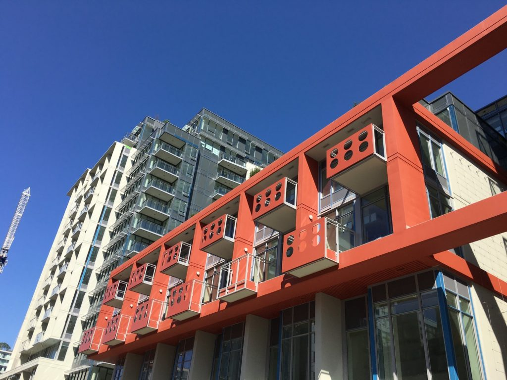 How the red balconies look in person at Block 100.