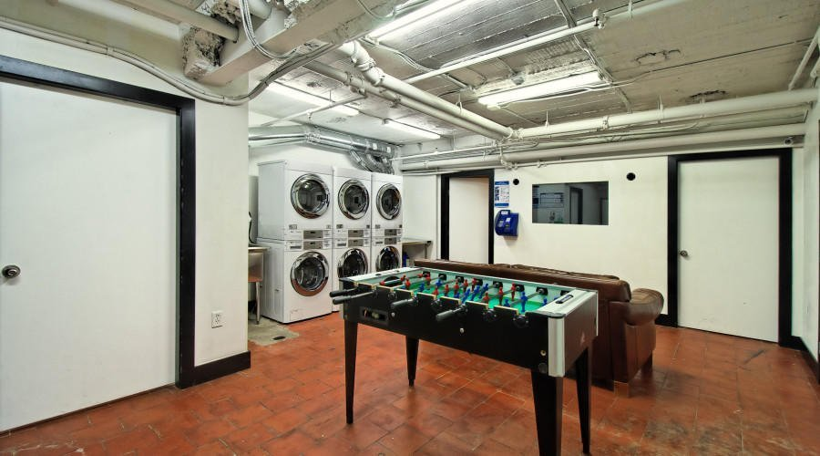 Laundry room with foosball table