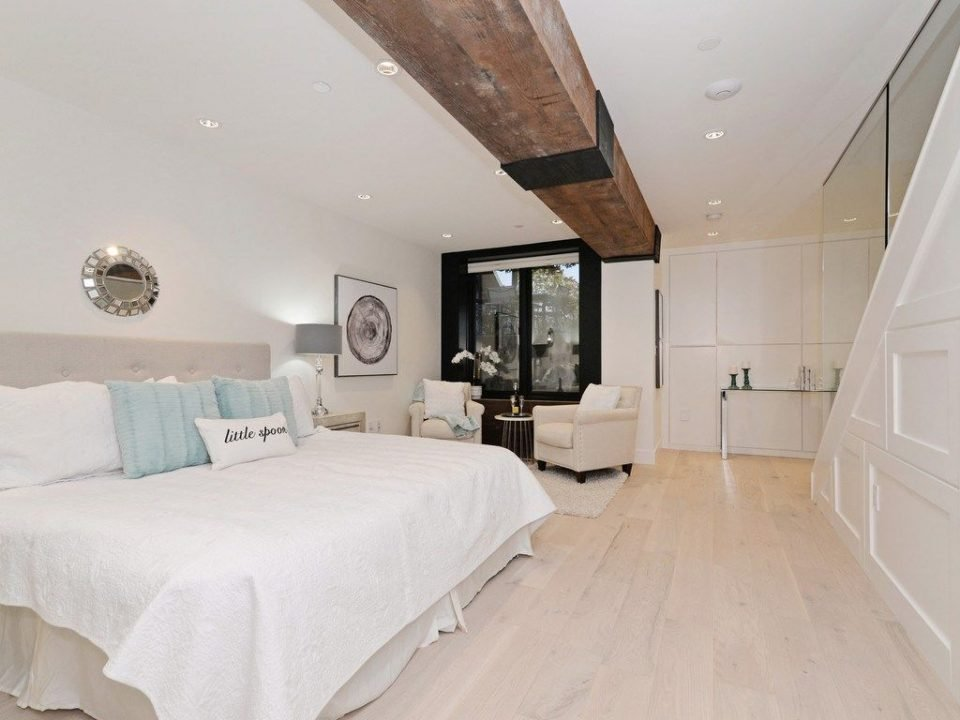Wood beam across bedroom