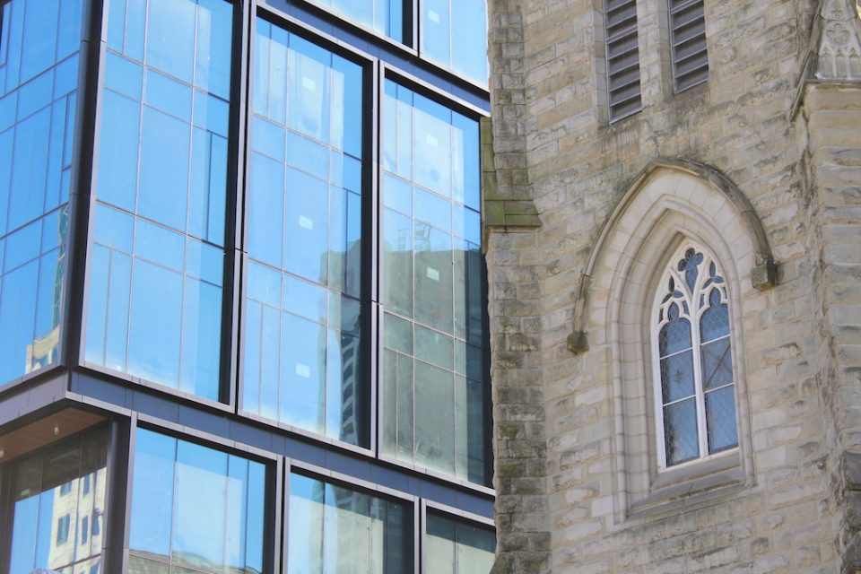Windows of 402 Dunsmuir next to the Holy Rosary Cathedral