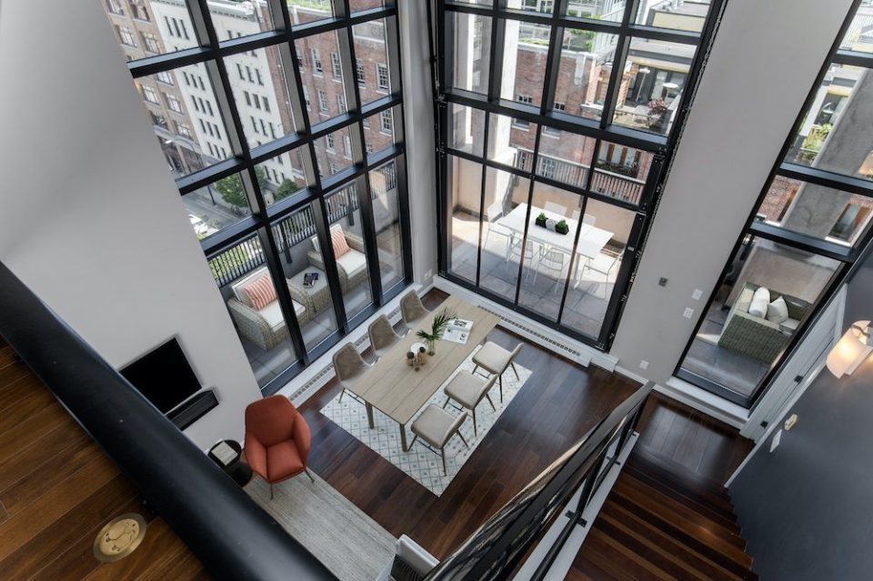 Penthouse loft with 19′ soaring ceilings for sale