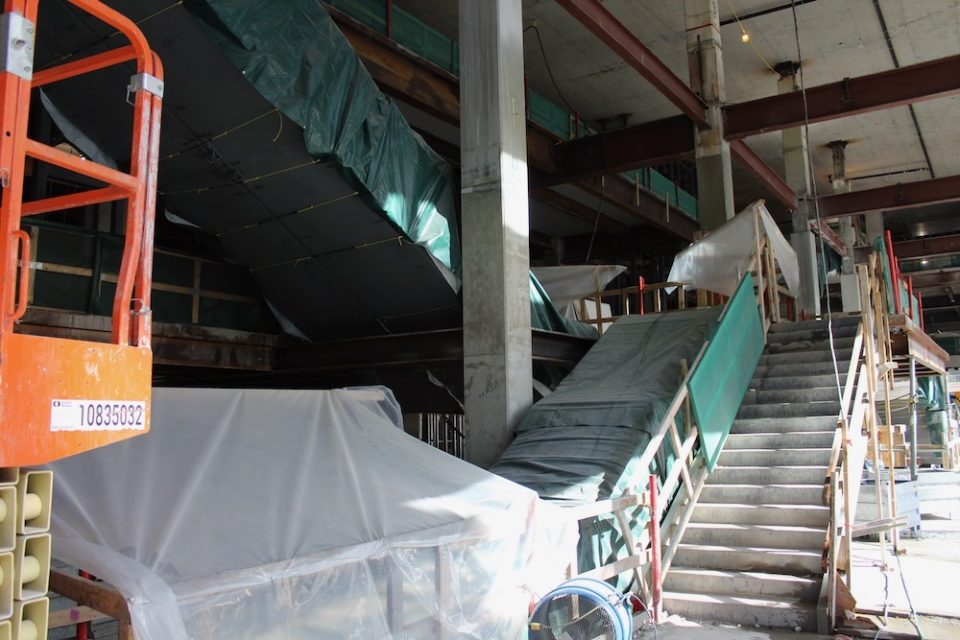 Escalators to retail level and future Loblaw CityMarket grocery store