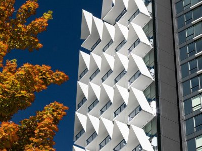 V-shaped white steel structures on façade