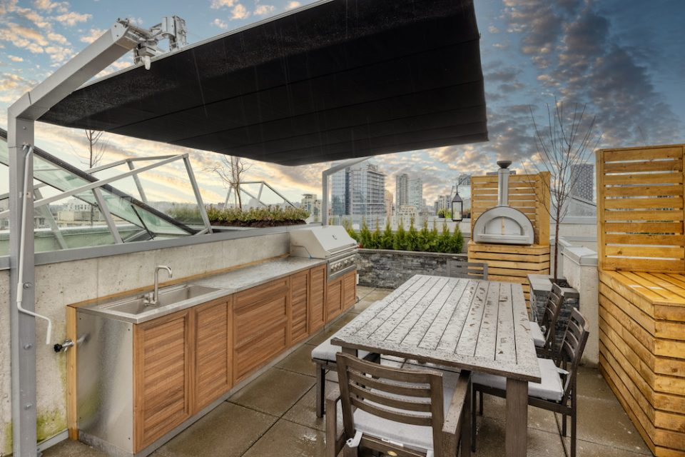 Rooftop patio with BBQ and dining area