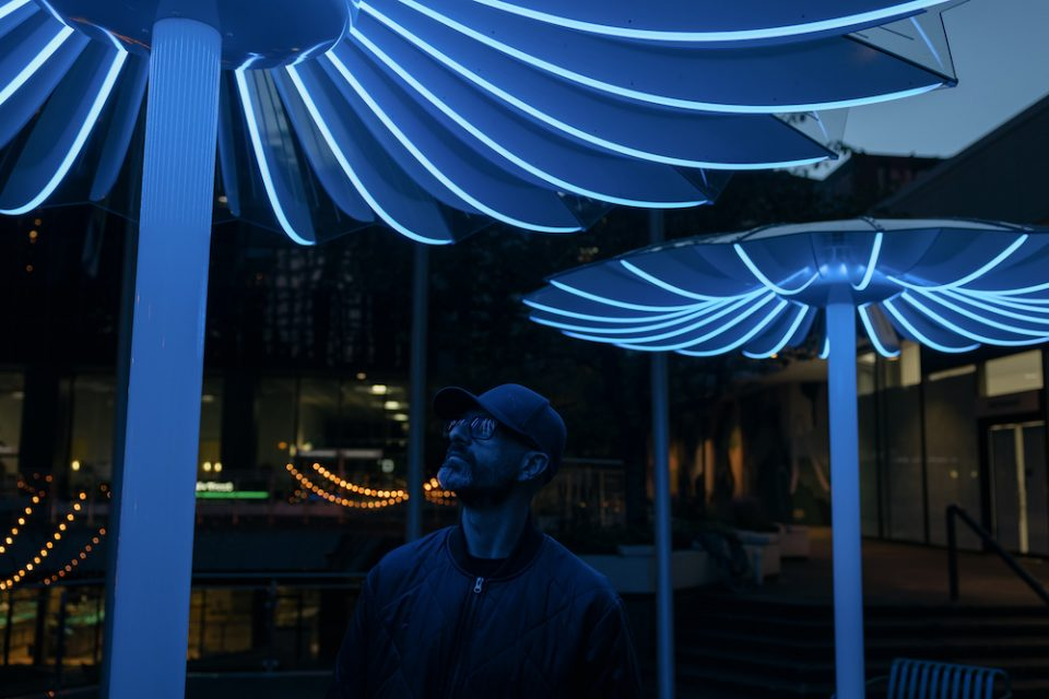 Bentall Centre parasols - A man's face is lit by the LED lighting