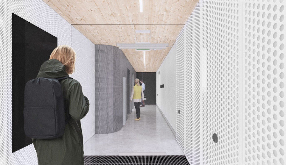 Entrance lobby, showcases the exposed CLT (cross-laminated timber) ceiling, contrasting walls clad in perforated metal.