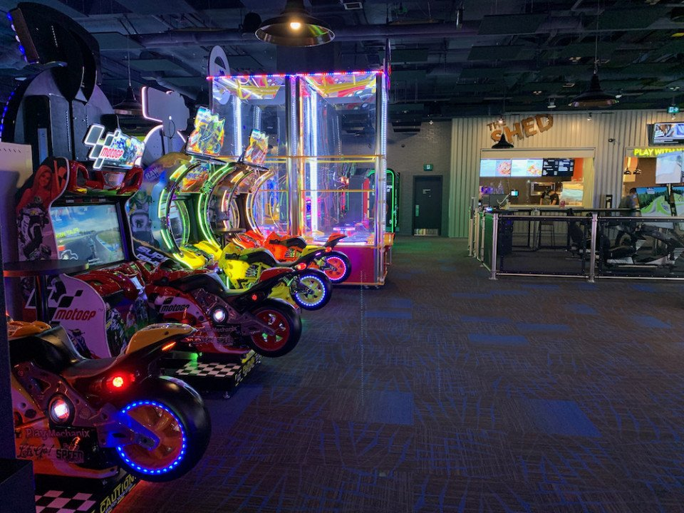 Motorcycling arcade games at the Rec Room Burnaby.