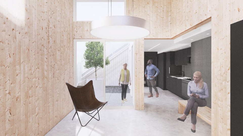 Interior amenity space, with exposed CLT (cross-laminated timber) walls.